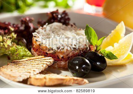 Salmon Tartare with Crispy Bread, Lemon and Salad Leaves