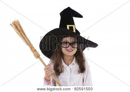 Child with halloween hat and a witch broom