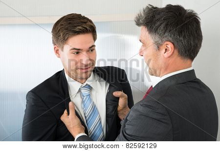 Two Businessman Fighting