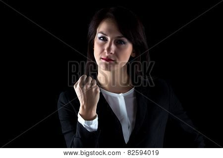 Photo of serious business woman showing fist