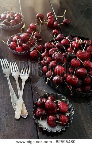 Fresh summer cherries in aluminum plates