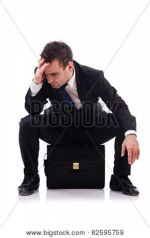 Sad businessman isolated on the white