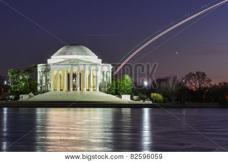 Washington DC - Thomas Jefferson Memorial night with trail lights of a taking off airplane  - United States of America