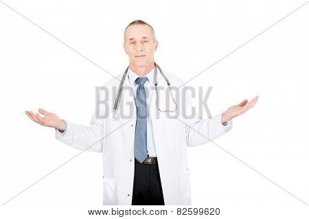 Mature male doctor holding copyspace in both hands.