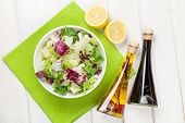 pic of condiment  - Fresh healthy salad and condiments over white wooden table - JPG