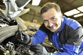 image of auto repair shop  - Technician working in auto repair shop - JPG