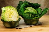 pic of neutral  - fresh savoy cabbage inside decorated  bowls over neutral background - JPG
