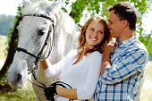 stock photo of appaloosa  - Image of happy woman with purebred horse and her sweetheart near by - JPG