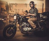 picture of rockabilly  - Rider and his vintage style cafe - JPG