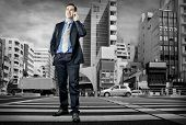 image of crossroads  - Businessman speaking by phone on the crossroad - JPG