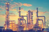 foto of refinery  - Oil refinery factory at twilight vintage color tone - JPG