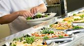 stock photo of buffet  - A shallow depth of field image looking along a sushi buffet bar - JPG