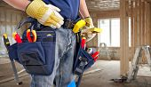 stock photo of carpenter  - Worker with construction tools - JPG