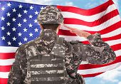 picture of citizenship  - Rear View Of A Soldier Saluting American Flag - JPG