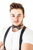 picture of emcee  - a handsome young man or hipster with braces and a bow tie isolated over a white background - JPG