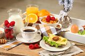 stock photo of continental food  - healthy continental breakfast on wooden table - JPG