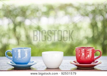 Three Cup Coffee On Wooden And Nature Background
