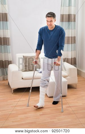 Disabled Man Using Crutches For Walking