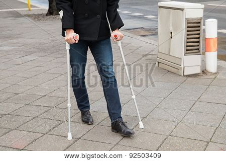 Man Trying To Walk Using Crutches