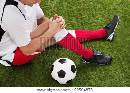 Soccer Player With Knee Injury