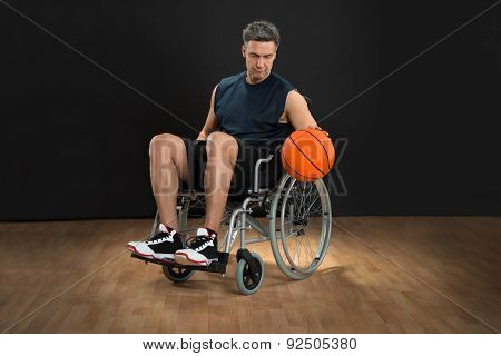 Disabled Basketball Player Throwing Ball
