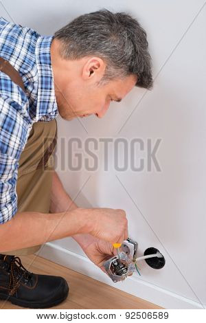 Male Technician Fixing Socket