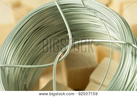 Coil of soft fictile pliable tin wire with bonding parts