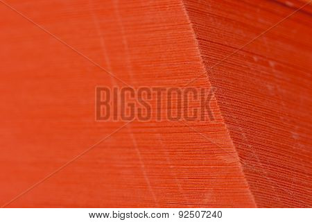 Stack of vivid and dark orange paper sheets