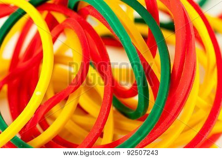 Rubber bands in yellow, red and green