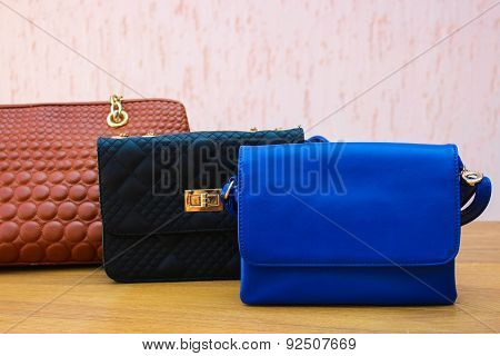 colored handbags closeup.