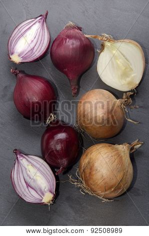 Red And White Onion On Slate