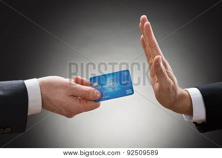Businessman Avoiding Credit Card