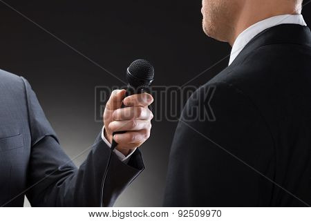 Reporter Conducting Interview Of Businessman