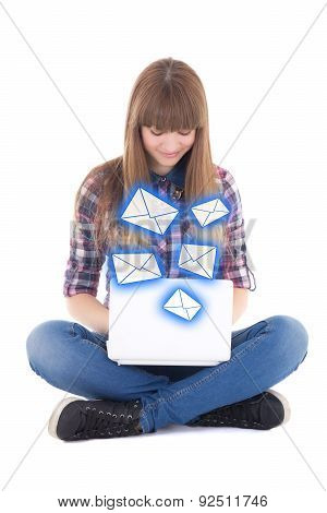 Cute Teenage Girl Sitting And Sending Messages With Laptop Isolated On White