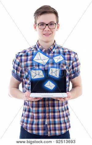 Spam Concept - Handsome Teenage Boy Sending Messages With Laptop Isolated On White