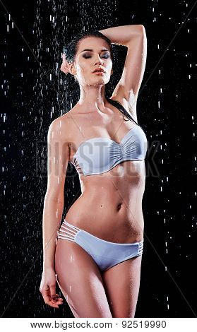 Portrait Of Sexy Young Woman Wearing Swimsuit In Water Studio