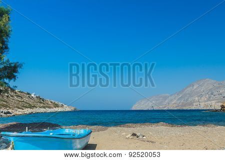Azure Fishermans Boat And Sea Horizon Line On Alexi Or Alexis Beach Near Emborios Greek Village On K