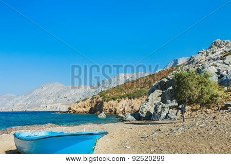 Blue Fishermans Boat And Evergreen Tamarisks On Alexi Or Alexis Beach Near Emborios Greek Village On