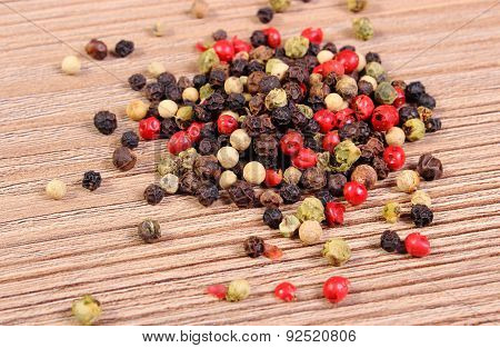 Heap Of Fresh Colored Pepper On Wooden Background