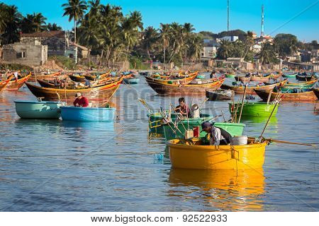 MUI NE, VIETNAM - FEBRUARY 08 - Fishermen in traditional small fishing boats