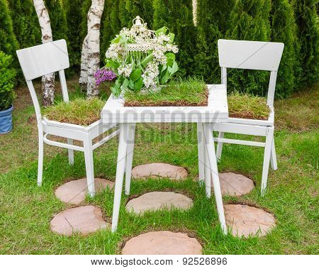 Minsk, Belarus, 23-may-2015: Garden Composition -  Table And Chairs Covered Green Grass, Birdcage Wi
