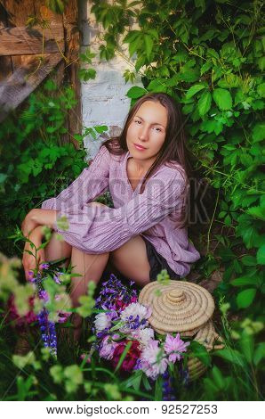 Tender Woman Resting In Grassy Thickets With A Beautiful Bouquet Of Peonies And Wildflowers