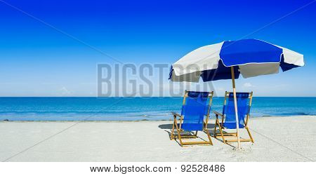 Sun Loungers And A Beach Umbrella On Silver Sand,  Vacation Concept