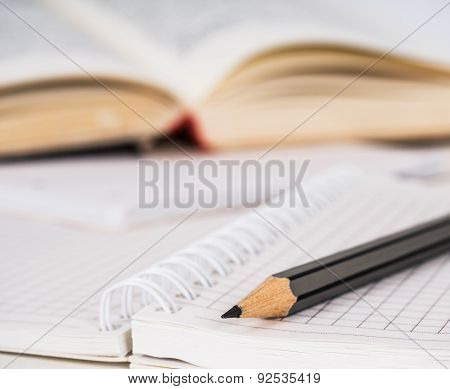 Wooden Pencil, Spiral Squared Paper Notebook And Opened Book