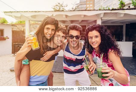Group of people having fun in summer party