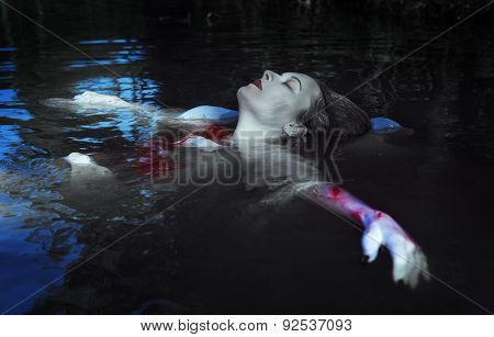 Beautiful Drowned Woman In Bloody Dress Lying In The Water