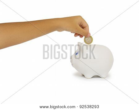 Closeup Of Woman's Hand Inserting Coin In Moneybox