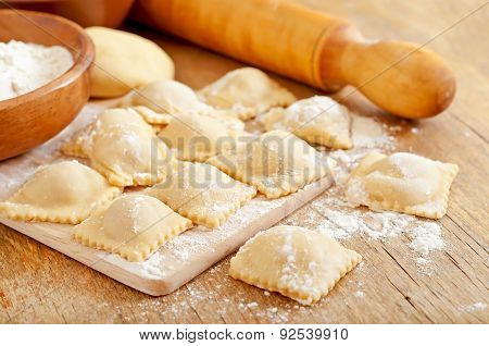 Freshly made homemade delicious homemade ravioli with a roller