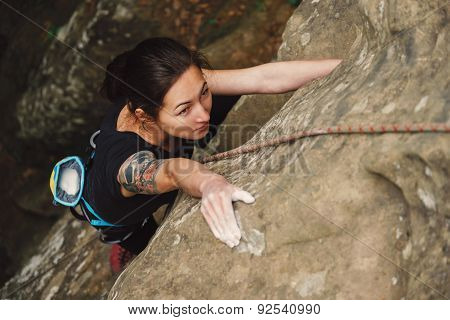 Beautiful Woman Climbing On Rock