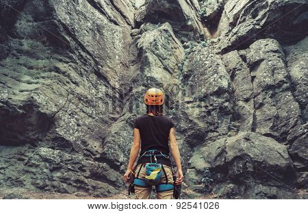 Climber Standing In Front Of A Rock